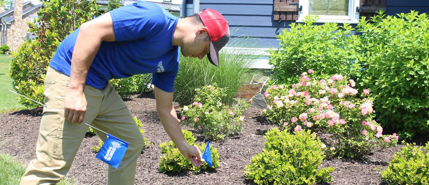 Conserva Irrigation repair specialist working on residential sprinkler system