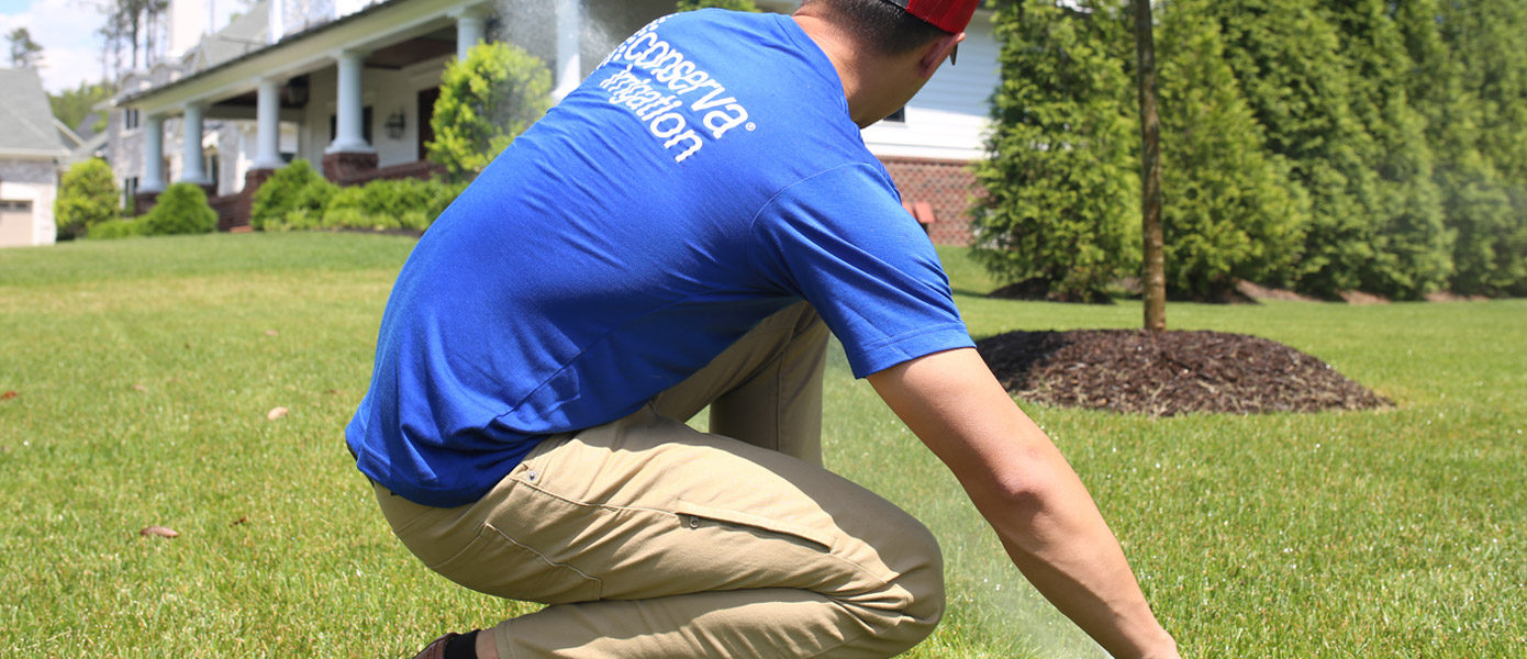 Conserva Irrigation Employee doing maintenance on home