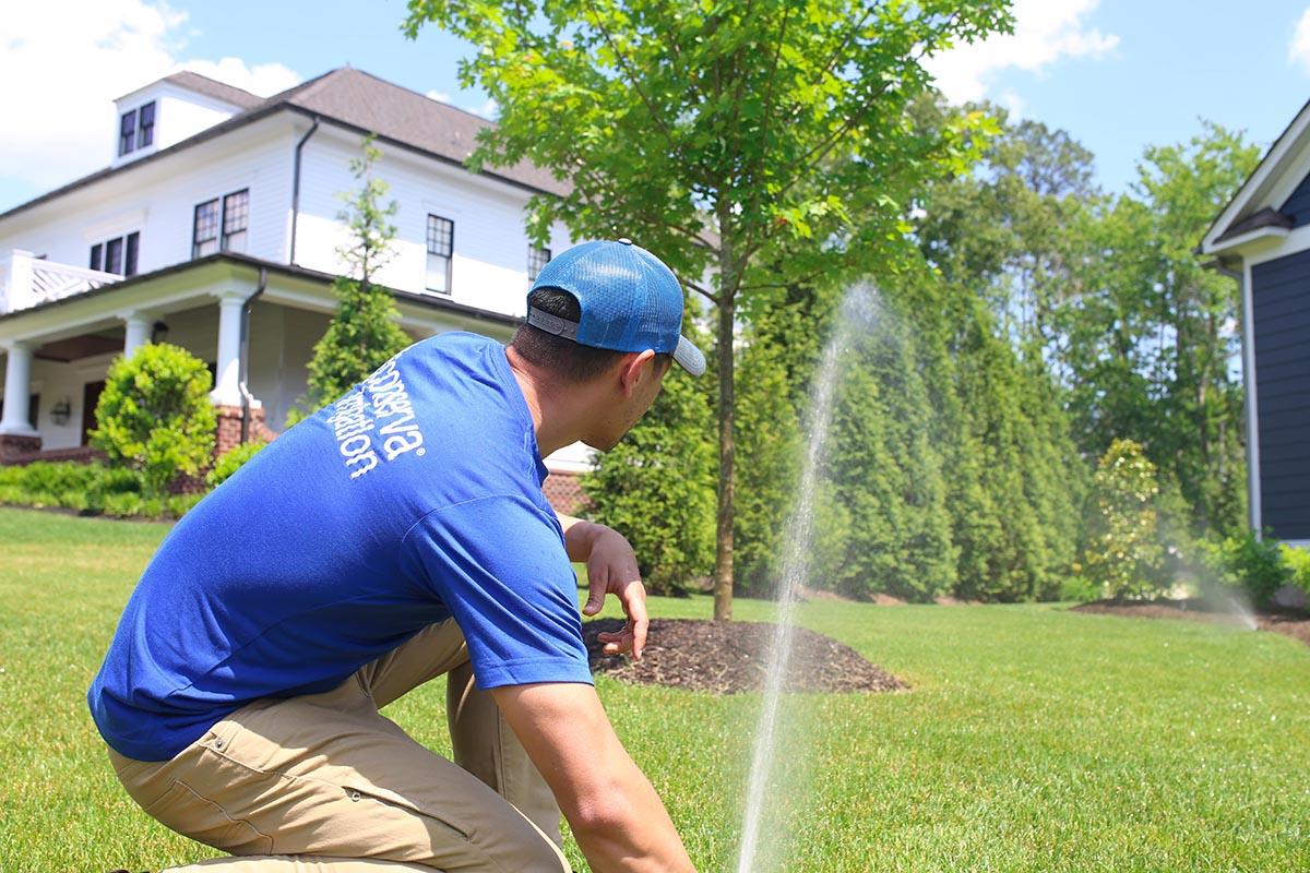 Conserva Irrigation Repair Specialist inspecting sprinkler system